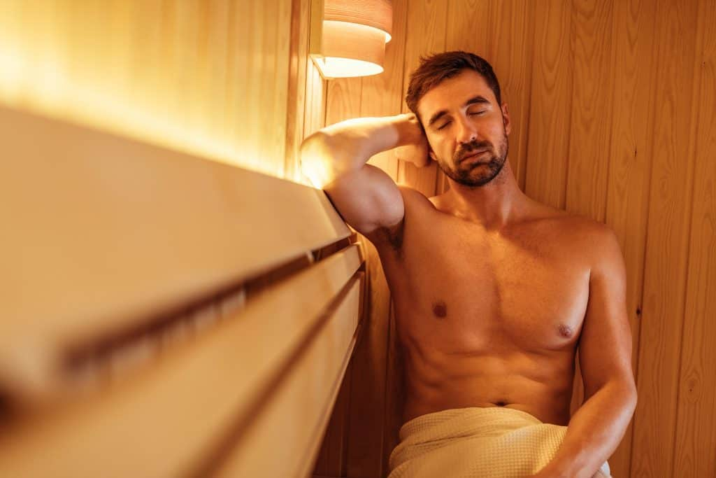 Enjoying sauna heat