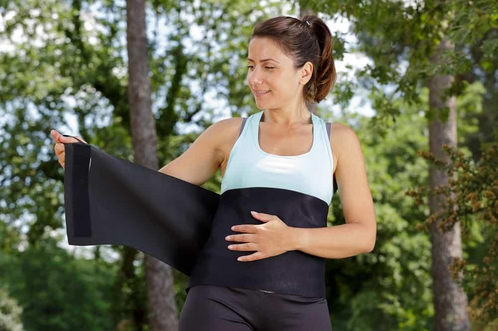 woman putting on waist